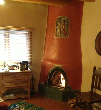 Adobe and Pines B&B:                   The Verde Room with kiva fireplace