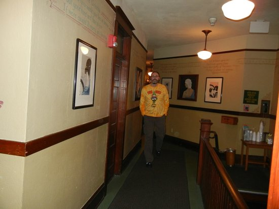 McMenamins White Eagle Saloon and Rock & Roll Hotel:                   orbs next to my husband in hall