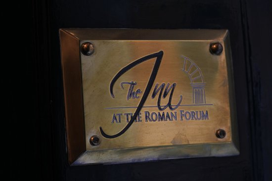 The Inn At The Roman Forum :                   The Hotel sign by the front door