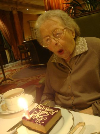 ... at The Dorchester: Grandma blowing out her candles on birthday cake
