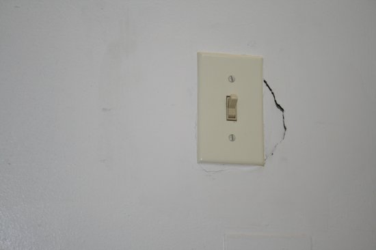 Grace Manor Inn:                   drywall at light switch in carriage house bath