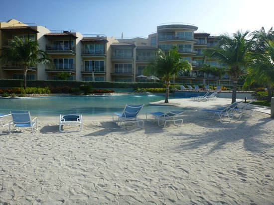 Oceania Residences:                   Beautiful sand beach beside the pool