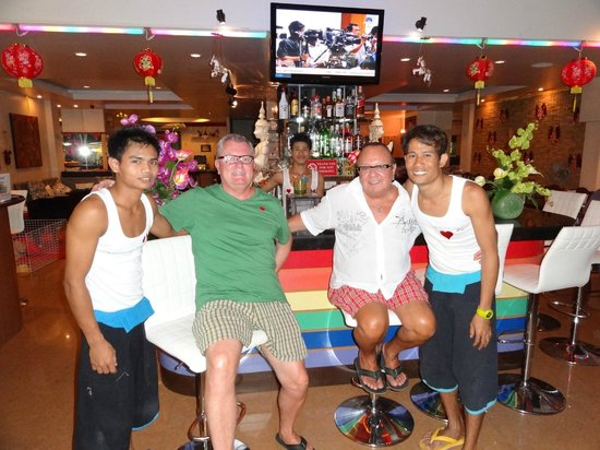 Club One Seven Phuket:                   Bar in lobby with staff