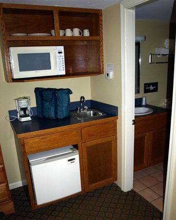 Madison, NH:                   Fridge, microwave and even dishes (a nice addition), bathroom was spotless