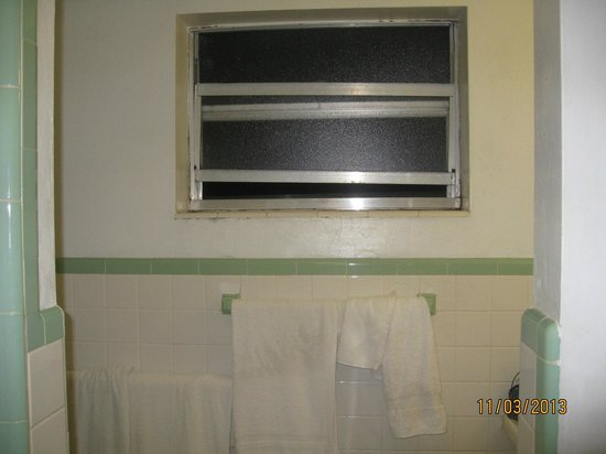 Sundeck Motel:                   Bathroom window which is old, dirty & hard to open & close