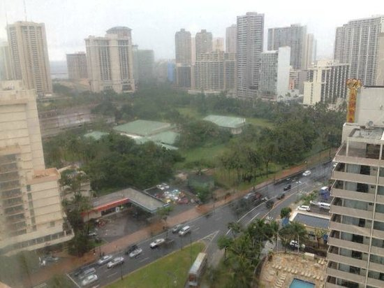 Maile Sky Court:                   A view from the room on a rainy day in Honolulu
