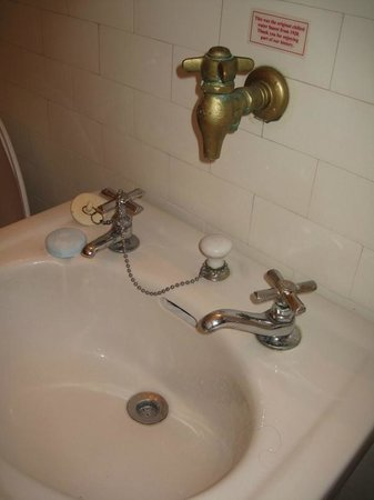 """Hotel San Carlos:                   Check out the old """"chilled water"""" tap. Note the old fashion sink stopper."""