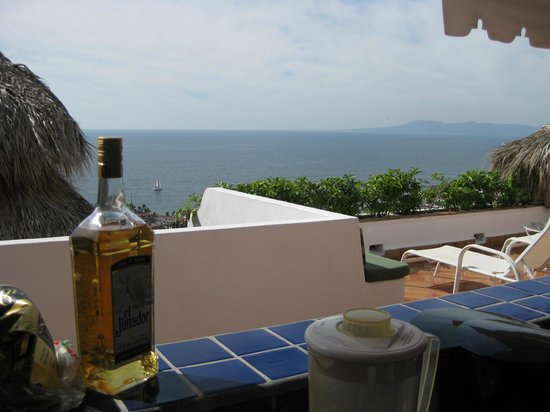 Casa de los Arcos: View looking out from the Casita kitchen accross the private terrace towards the Bay of Banderas