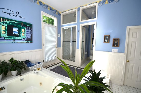 Sugar Magnolia Bed & Breakfast: The Royal Suite bathroom - shows door to rooftop deck, shower, and toilet.