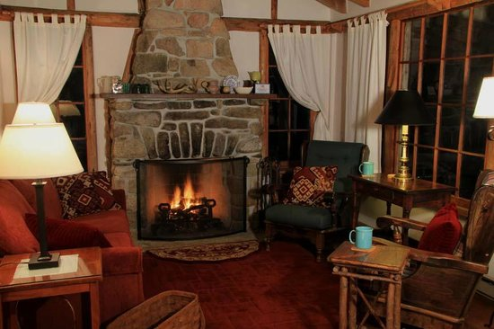 Brooksville, ME: Flagstaff Cottage's living room at night.