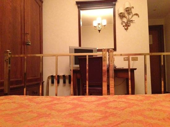Albergo Cesari: Eye-view from a laid position of the TV in the room. This is offensive!