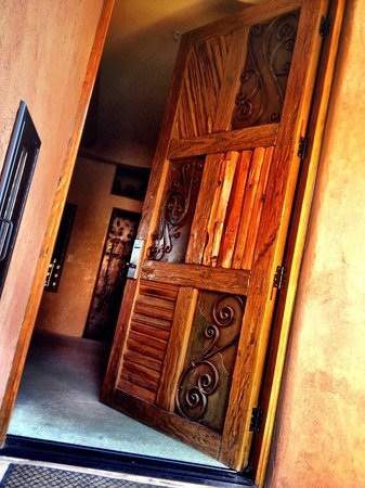 Adobe Grand Villas: Massive , artistic doors welcome us into our villa