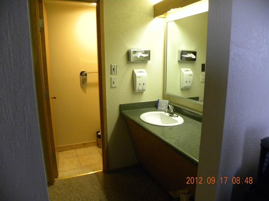 Far View Lodge: Sink on right - clothes hanging area on left - looking into toilet and shower area