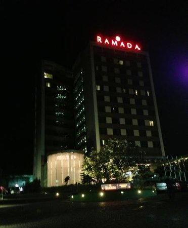 Ramada Powai: hotel exterior from driveway at night.