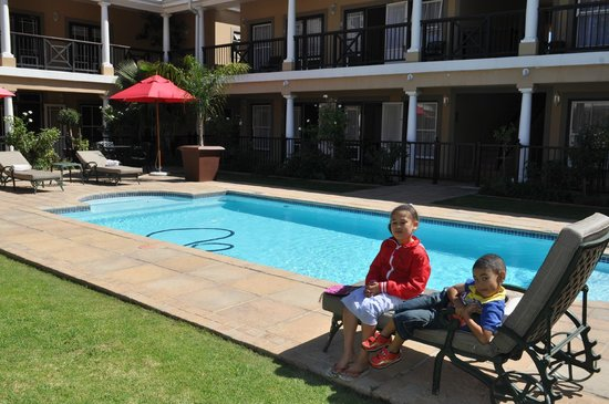 Protea Hotel Franschhoek: my kids at pool, just before we had to check out.