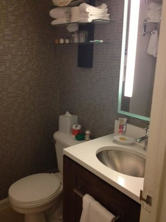 Rouge, a Kimpton Hotel : bathroom is a little small, but great mirror with light built in. 