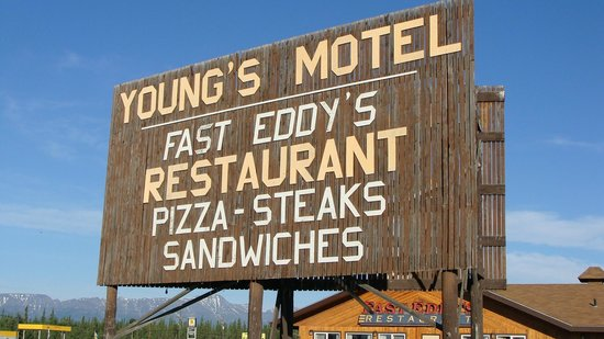 Tok, : Sign of Young Motel and Fast Eddys Restaurant they are side by side