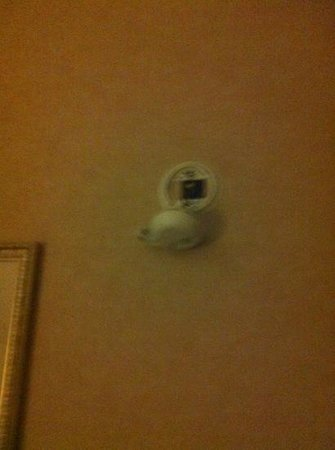 Byram, MS: smoke detector hanging off wall