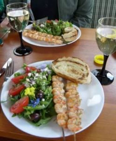 Lund, : Lunch plate consisting of skewered barbecue prawns and locals greens.