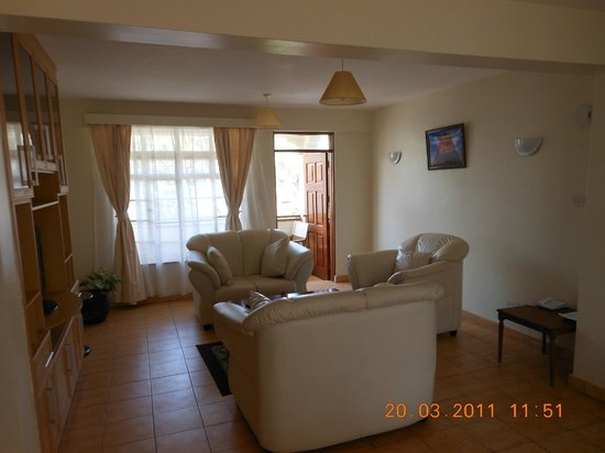 Ole Dume Serviced Apartments Hotel: Chairs and door to balcony