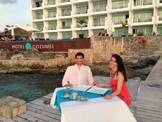 Hotel B Cozumel: Sunset dinner. The candles didn't work because of the wind, but they gave it their best!