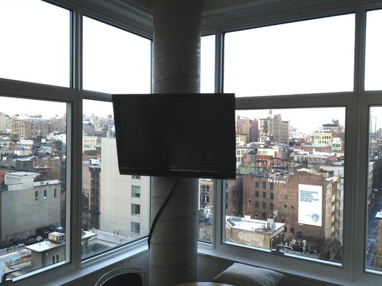 The James New York : Out the window on the 9th floor. TV mounted on exposed structural element with swagged cable 