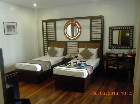 Lotus Garden Hotel: Bedroom area