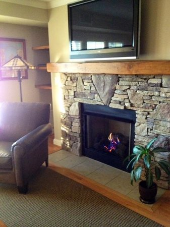 The Residences at Biltmore: living area and fireplace