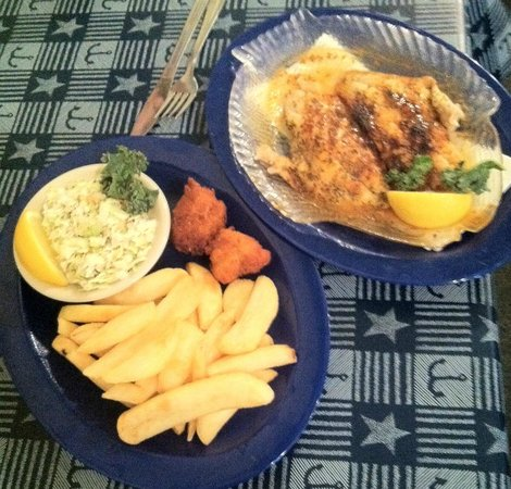 Alachua, FL: Broiled Grouper, steak fries, slaw and yummy hush puppies.