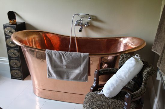 Koroit, Australia: A Brass bathtub in another room