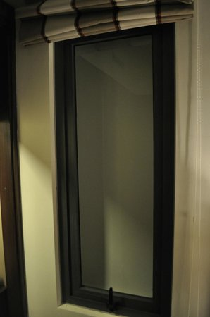 """Authentic Hanoi Hotel: The """"window"""" in our first room.  Strange"""