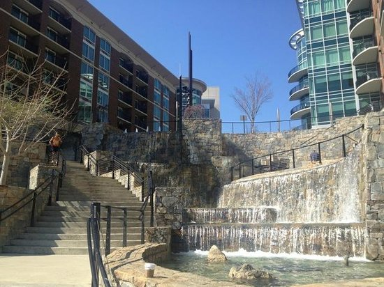 Hampton Inn &amp; Suites Greenville - Downtown: View from the river to the hotel (on the left)