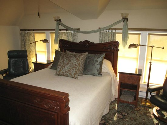 , : The bedroom of Top of the World Suite glows in the afternoon sunlight