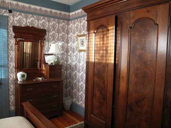 , : Antique walnut armoire and dresser enhance Helen&#39;s Room