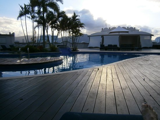 Pullman Cairns International: the pool at dusk