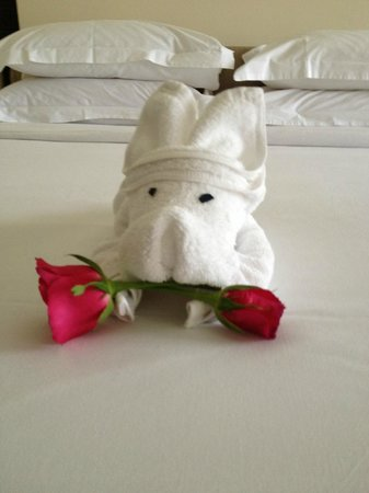 ‪‪Thara Patong Beach Resort & Spa‬: Dog on bed with rose‬