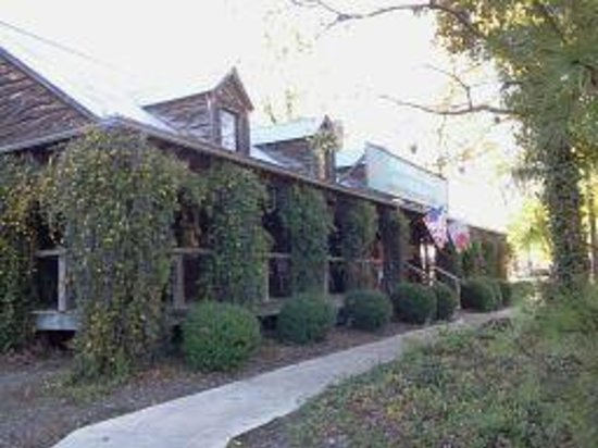Exterior Of The Farmhouse Rocking Chairs And Large Veranda