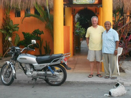 Casita de Maya: Daniel and his moto at front entry.