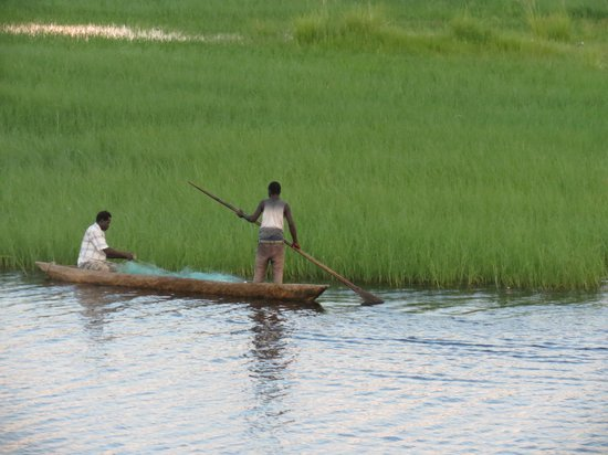Zambezi Queen: Men on a Mokoro Canoe