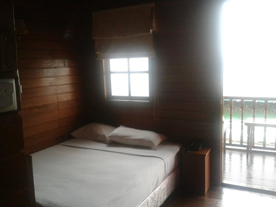 PT. KTM Resort - Batam: The Wooden panelled room with window and balcony. Amazing.