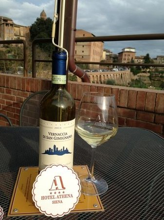 Enjoy a bottle of wine on the 7th floor of Hotel Athena terrace!