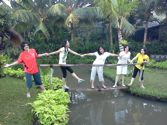 Omah Apik: Having a good time - the hotel has a pond in the garden