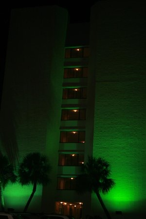 Top of the Gulf Suites: front of top of the gulf at night