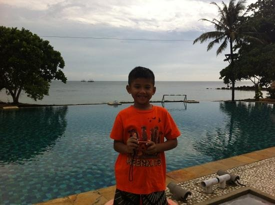 ‪‪Tanjung Lesung Bay Villas Hotel & Resort‬: my boy standing in front of swimming pool‬
