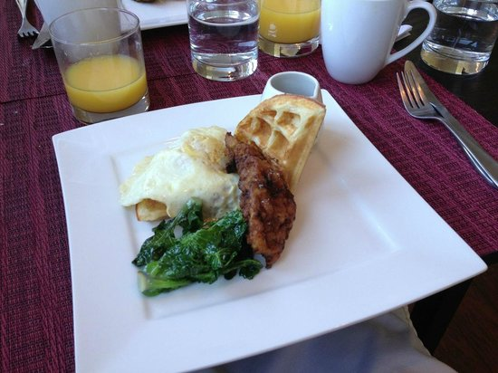 Olea Hotel: Gourmet Breakfast: Garam masala spiced fried chicken, waffle, maple syrup, lollipop kale, fried