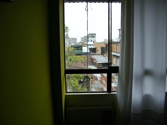 You look out over the rooves and backyards of Iquitos from the back of the Amazon Apart Hotel
