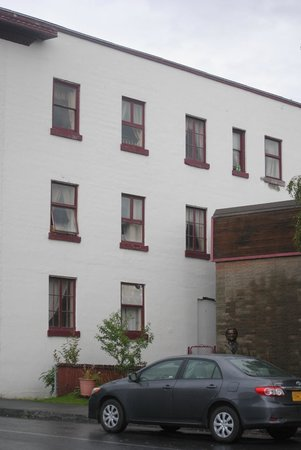 The Van Gilder Hotel: The side of the Van Gilder. My room was fourth from the left on top (see the bottles on ledge?).