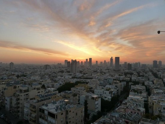 : View from Room 11th floor room - Sunrise over Tel Aviv