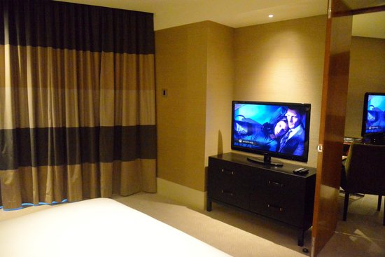 Crown Towers: Bedroom TV and look out to living room