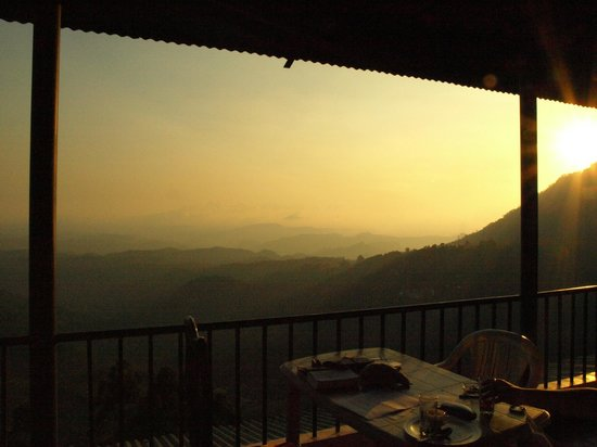 Misty Green View by wilson tours: Sunset from balcony